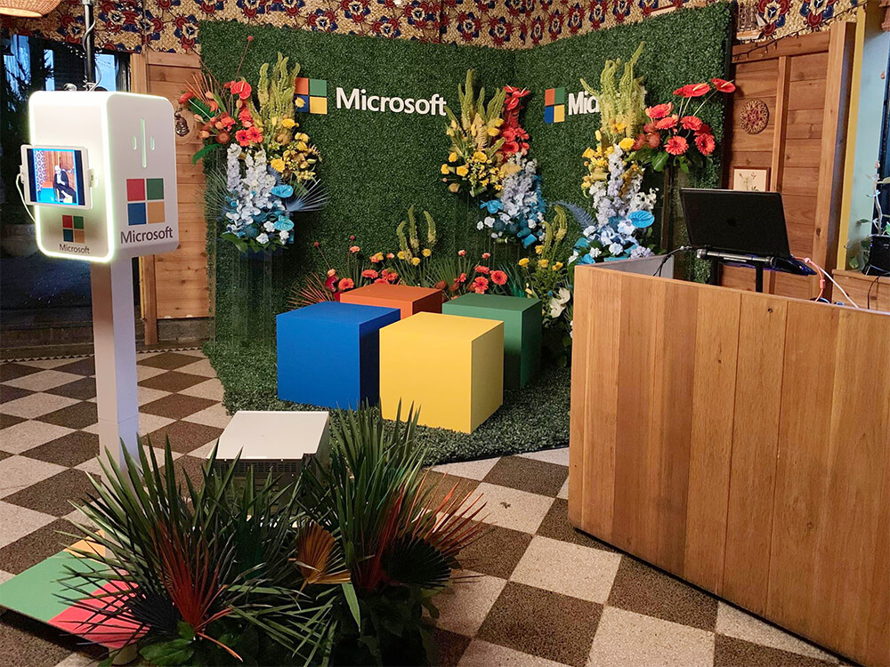 Custom Set Design with floral and hedge walls for Microsoft Event