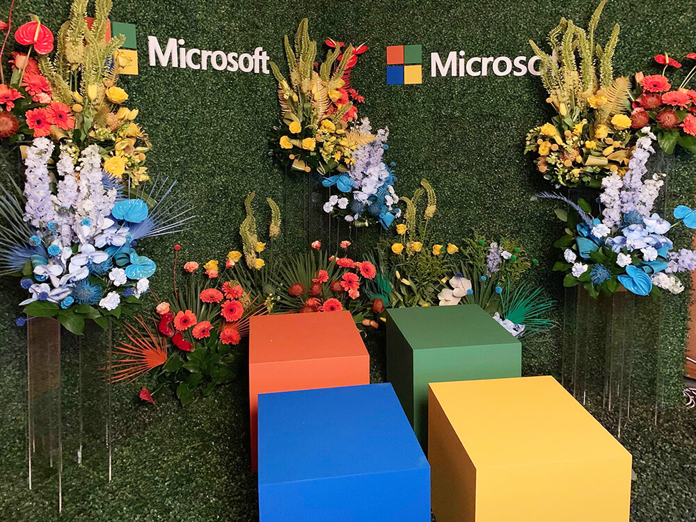 Microsoft Photo Booth with Custom Set Design using Boxwood hedging and florals